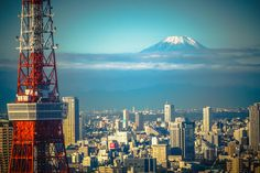 Snow capped Mount Fuji (雪化粧の富士山) floating in the sky, with Tokyo Tower (東京タワー) and Tokyo city skyline,  in Tokyo (東京) Japan.  Camera Information:  Model: Sony ILCE-6000 (A6000) Lens: Lens: Sony E 55-210mm f/4.5-6.3 OSS Zoom Lens E-mount (SEL55210).