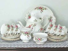 Royal Albert fine English bone china tea set 'Moss Rose'. Cups saucers and plates, cake plate milk jug sugar bowl, cake plate. Teapot for display only - cracked botton- suitable for floral display)  all for hire www.highteahire.co.nz