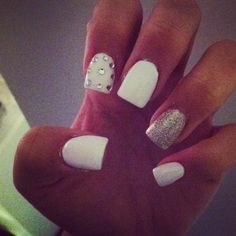 White acrylic nails with glitter and diamond accents
