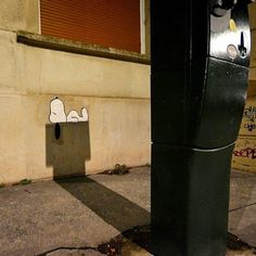 Street artist transforms a parking meter shadow into a perfect silhouette of Snoopy's dog house.