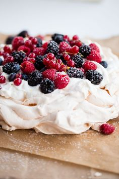 Easy Lemon Berry Pavlova Recipe - a delicious pavlova filled with lemon whipped cream and mixed berries! A great celebration dessert for spring or summer.