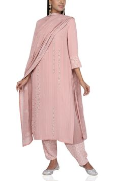 Anjul Bhandari dresses you up for a work week day in this blush pink pintuck suit with bead detailing and paired with a chikan dupatta. Style it with white kitten heels and a pair of pearl drop earrings. Silk Kurti Designs, Kurta Designs Women, Churidar Designs, Kurti Embroidery Design, Embroidery Fashion, Couture Embroidery, Pakistani Dresses Casual, Pakistani Dress Design, Indian Designer Suits