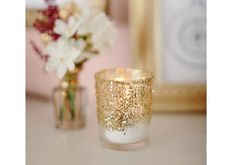 For the ombre votive, apply more Mod Podge to the bottom (or top, depending on which way you want the ombre) of the votive. Gradually apply to the other half, leaving a quarter inch with no glue. Sprinkle glitter and let it dry.
