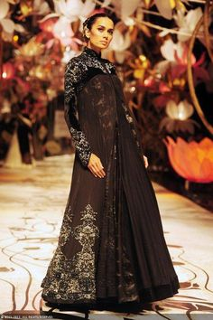 A model showcases a creation by designer Rohit Bal at India Bridal Fashion Week (IBFW) 2013