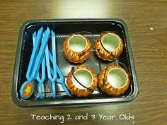 Teaching 2 and 3 Year Olds: A COLLECTION OF PRESCHOOL ACTIVITIES FOR FALL - using tweezers and small pumpkins for a fall fine motor activity. Add whatever small items you wish to transfer into the pumpkins.