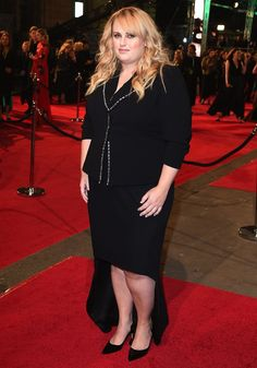 Rebel Wilson - Rebel Wilson opts for an all-black ensemble with chic white nails and tousled hair. We love her Marina Rinaldi jacket and cool, custom-made skirt.