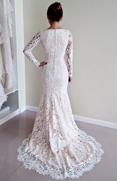 Designer lace wedding gown by Polinalvanova via etsy with long sleeves and satin covered back buttons. This gorgeous dress will have all eyes on you. #weddingdress #lacedress