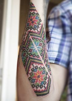 Cross stitch tattoo? Also looks a bit like a beaded belt or friendship bracelet. Either way, pretty unique!