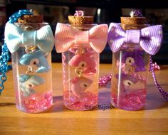 micro handmade charms ( 1cm) in little glass bottles (4cm ) with water, pink transparent beads and glitter *w*