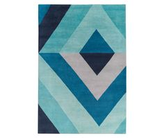 Resembling an optical art piece, this hand-knotted Sybil Diamond Blue rug by The Rug Company brings cool colours to Zen sleeping quarters.