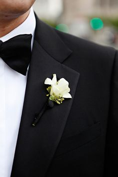 Classic, simple white dendrobium orchid boutonniere {Evantine Design, Photo: Marie Labbanz}