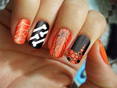 Orange, black and white Halloween scenes on nails from 22 Simple And Cute Halloween Nail Art Ideas