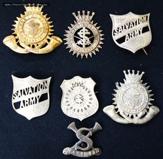 Group of vintage Salvation Army badges including cap badges with the Motto blood and fire