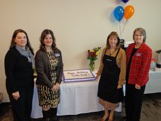 Rachel Bishop (Castle Rock Receptionist), Jill Garber (Director of Extension Campuses), Dr. Diana Doyle (ACC President) and Peggy Quinn (Castle Rock Campus Manager) celebrate one year of operation at the Castle Rock Campus.