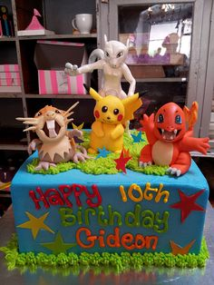 Square Wicked Chocolate cake iced in blue butter icing, decorated with 3D Pokemon character figurines, piped message & fondant stars by Charly's Bakery, via Flickr