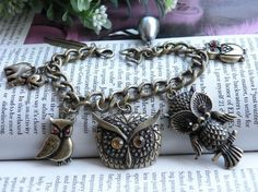 Owl Charm bracelet from Etsy. THIS IS SO CUTE!