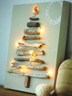 Driftwood Christmas Tree Make a Christmas tree canvas with driftwood and string lights. Christmas Tree Canvas, Driftwood Christmas Tree, Diy Christmas Tree, Winter Christmas, Christmas Lights, Christmas Time, Xmas Tree, Christmas Pictures, Simple Christmas