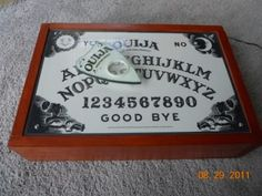 """Awesome DIY animated Ouija board using a vent motor...I've been looking for one of those """"ice skater"""" Xmass displays to do this with..."""