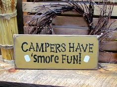 "This wood camping sign is made from pine, and measures Approx 5.5""W x 13""L. It reads ""Campers Have Smore Fun"". The front is painted a Mustard Yellow then distressed, the back is stained . We've used a"