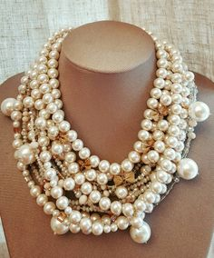 Check out this item in my Etsy shop https://www.etsy.com/ca/listing/465188942/chunky-multistrand-ivory-glass-pearl-and