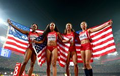 Allyson Felix Photos Photos - Francena McCorory of the United States, Sanya Richards-Ross of the United States, Natasha Hastings of the United States and Allyson Felix of the United States celebrate after winning silver in the Women's 4x400 Relay Final during day nine of the 15th IAAF World Athletics Championships Beijing 2015 at Beijing National Stadium on August 30, 2015 in Beijing, China. - 15th IAAF World Athletics Championships Beijing 2015 - Day Nine