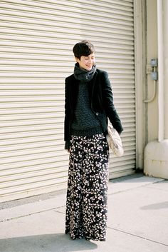 oooh, big great sweater, black jacket, long skirt