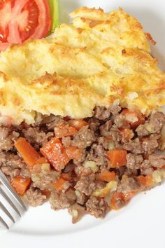 The Best Shepherd's Pie Recipe with Potatoes, Onion, Cheddar Cheese, Carrots, Ground Beef, Worcestershire Sauce, Flour, Ketchup, and Brown Gravy Mix
