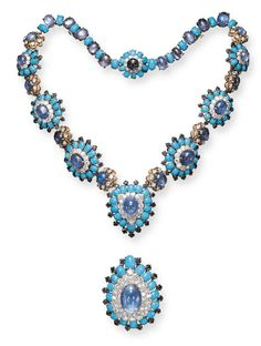 A SAPPHIRE, TURQUOISE, DIAMOND AND GOLD PENDANT NECKLACE, BY DAVID WEBB  Centering upon a pear-shaped detachable pendant, set with a cabochon sapphire, within a pavé-set diamond, cabochon turquoise and rectangular-cut sapphire frame, suspended by a graduated series of similarly-set plaques, joined by cabochon sapphire and circular-cut diamond flowerhead links, joined to an alternating cabochon sapphire and turquoise back chain, mounted in platinum and 18K gold