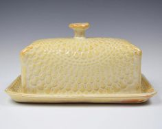 I made this piece by hand by shaping slabs of stoneware clay. I added texture using a vintage doily. This beautiful toasty cream glaze is food safe and this dish can be put in the microwave and dishwasher. This piece measures 7 long, 4.5wide, and 3.5 high at the knob. The bottom is hand signed and sanded smooth to protect your surfaces.
