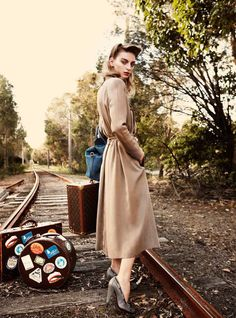 Roaring 40′s – Rose Smith gets a retro makeover for the November issue of Australian publication, Madison Magazine. Photographed by Carlotta Moye with styling by Rachel Wayman, Rose joins male model Zac Stenmark in a train station love affair. Wearing a wardrobe of 40′s inspired selects from the likes of Miu Miu, Louis Vuitton and Mulberry, the Aussie beauty wows in red lips by Victoria Baron and soft curls by Travis Balcke.