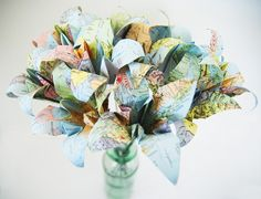 Recycled atlas travel wedding bouquet- would also be cool to make bouquets from maps from vacations