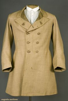 "GENT'S BEIGE FROCK COAT, 1850-1870      Lot: 50      November, 2007 -Tasha Tudor Historic Costume Collection      New Hope, PA    Wool twill, double breasted, ten woven thread buttons, waist seam and skirts, sleeves with plain cuff, center back vent with buttons above two hidden pockets in pleats, horizontal waist seam except at 4.25"" center back, mushroom silk twill lining, (scattered stains, small moth holes, two missing front buttons) good."