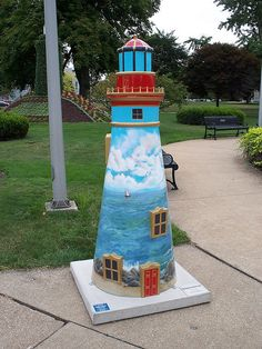 "Sandusky, Ohio - A Light in the Harbor 2008 - ""From the Eye of the Fresnel"" - 28 fiberglass lighthouse statues, 5 feet high"
