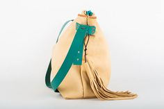 This every day carries all beige leather bag is a stylish and practical cross body hobo bag that is hand crafted of buttery soft and versatile leather. It comes paired with a gorgeous turquoise zipper and adjustable strap, as well as with a pair of soft and buttery leather tassels. Height: 26 cm/ 10.5 inch  Width: 36 cm bottom, 47 cm top/ 14 inch bottom/18.5 inch top  Deep: 11 cm/ 4.3 inch  Adjustable strap: 110 cm/ 43.3 inch This bag is exclusively handcrafted. The l... Leather Tassel, Leather Bag, Everyday Carry, Hobo Bag, Leather Craft, Cross Body, Bucket Bag, Things To Come, Pairs