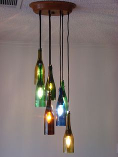 wine bottle chandelier (etsy) - No DIY & item unavailable but note ceiling plate & arrangement