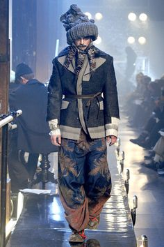 Galliano Men's wear 2011 inspired by Russian Ballet. Textured jacket with peeking out sweater cuffs