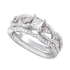 This enchanting diamond engagement ring and wedding band are complimented by ornate spiraling diamonds on 14K white gold.