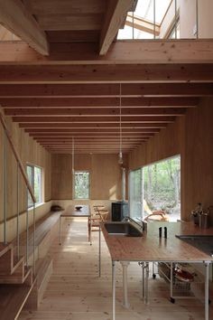 Sliding glass doors connect the patio with the main family room inside this Japanese house | Wood design