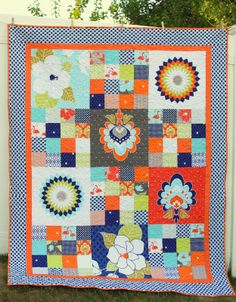 Diary of a Quilter - a quilt blog: Panel Quilt Tutorial for Riley Blake (Like mixing solid squares with patchwork squares)