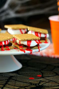 Eeek. Make Bloody Halloween S'mores. As easy to make as they are creepy. #halloween