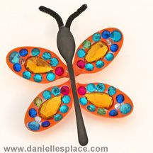 Butterfly craft made with plastic spoons and sequins and more!