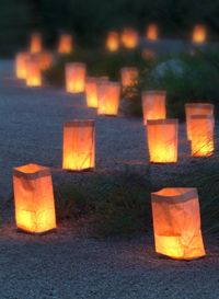 luminaries-fold down white paper bags and put sand in bottom to help them stay weighted
