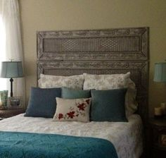 Separation screen recycled as a headboard