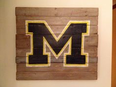 University of Michigan wall hanging. Hand painted on reclaimed wood. $45.00