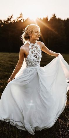 This is a long chiffon beach wedding dress with lace. It is a sleeveless wedding dress. Silhouette:A-Line Hemline/Train:Sweep Train Neckline:Halter Fabric:Chiffon Embellishment:Lace Sleeve Length:Sleeveless Waist:Natural Back Style:Zipper-Up Lace Bridal, Lace Wedding Dress, Country Wedding Dresses, Long Wedding Dresses, Bridal Dresses, Lace Dresses, Elegant Dresses, Wedding Gowns, Country Weddings