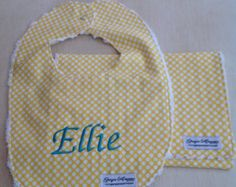 Made with 100% cotton designer aqua fabric with soft, absorbent white chenille on back. Both bib and burp cloth are top stitched for durability. Both items are tagged for a professional look. Bib has pearl snap for easy closure. Perfect fit to keep bib on baby.  Fits most 3 months and up. For name personalization please include correct spelling of the name in message area. All personalized items are non returnable so please double check spelling. For monograms please include name with…