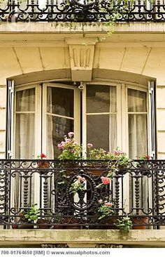 Paris apartment balcony...I so see me there greeting the morning with a cup of coffee. :)