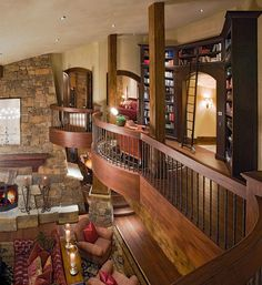Built-in book cases, wood and stone, overlooking the living room.