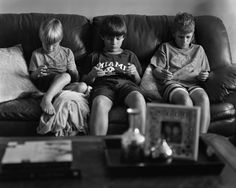 This is from a photography project entitled 'Removed' by Eric Pickersgill, I like the composition in the picture, that it's black and white and that the three kids all have different technology showing its not just phones and how our dependency is influencing children