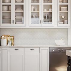 Kitchen with white cabinets and ceramic scallop grey tile backsplash. #Kitchencabinets